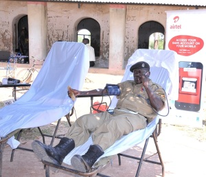 A police officer donates blood at the airtel community health fair in Arua