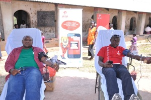 Volunteers from airtel and Hind's Feet Project donate blood at the Airtel community health fair in Arua.